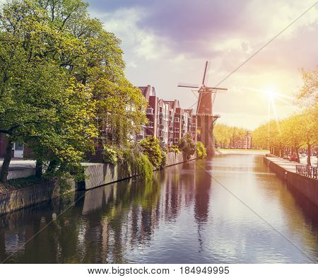 Amsterdam canal at sunset. Amsterdam is the capital and most populous city in Netherlands
