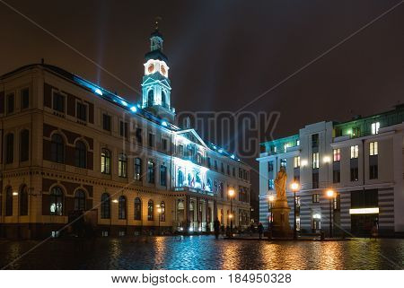 Riga City Council building illuminated with lights at night