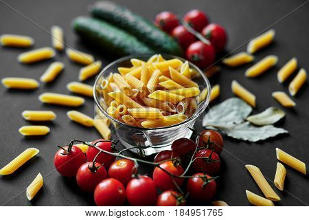 Still Life With Pasta, Cherry Tomatoes And Cucumbers. The Texture Of Pasta. Vegetables. Italian Past