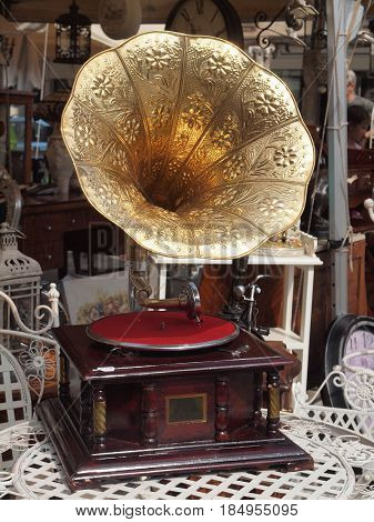 Golden gramophone for sale at the flea market