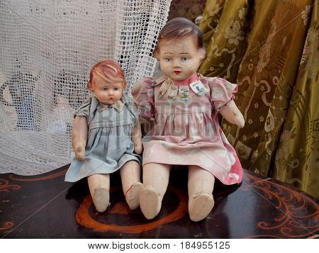 Two old dolls for sale at the flea market