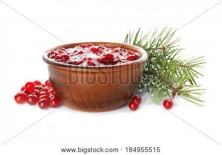 Delicious cranberry sauce in bowl on white background