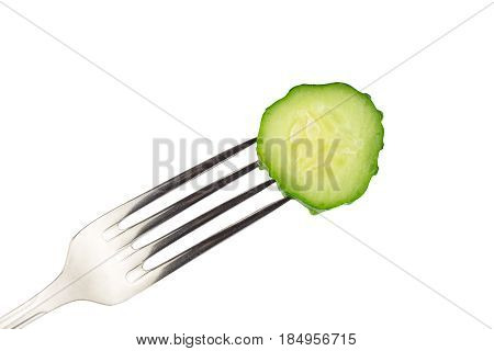 Slice cucumber impaled on fork isolated on white background close-up view