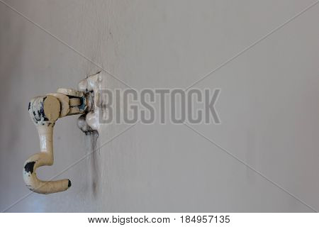Chipped paint on a hook to secure door aboard a ship