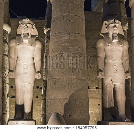 Statues Of Ramses Ii At Luxor Temple In Night