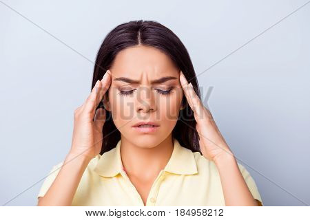Close Up Portrait Of A Young Pretty Hispanic Woman Having Headache After Stressful Workday And Touch