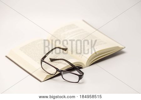 Open Thick Book With Glasses On It Isolated On White Background