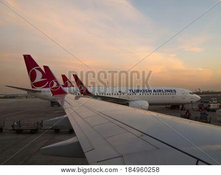 ISTANBUL, TURKEY-MARCH 24, 2017: Turkish Airlines jets sit on the tarmac at Ataturk International Airport in Istanbul, Turkey