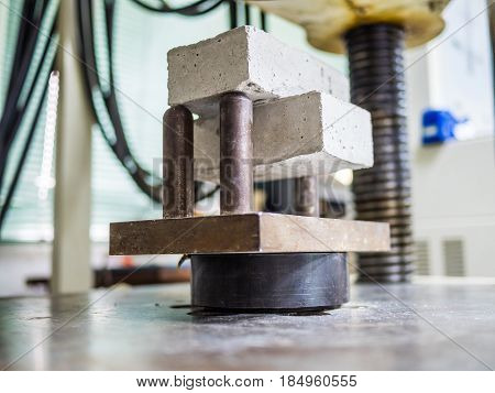 physical testing machine in engineering laboratory with load cell to calculated compressive strength or tensile and flextural property