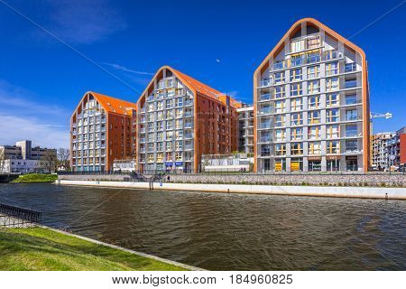 GDANSK, POLAND - MAY 4, 2017: Architecture of modern apartments at Motlawa river in Gdansk, Poland. Riverside buldings are situated in the city center near the old town of Gdansk.
