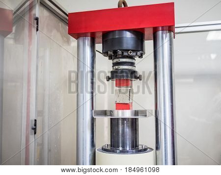 physical testing machine in engineering laboratory with load cell to calculated compressive strength or tensile and bonding property