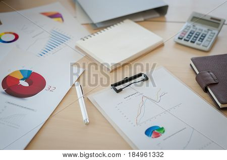 Business documents on table in office. Working analysis using graphs abd charts.