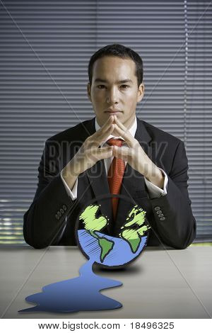 Business man concerned over state of earth, global warming and climate change theme