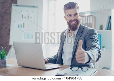 Well Done! Successful Happy Businessman Is Showing Thumb Up. He Is Handsome, Smiling, His Company Ac