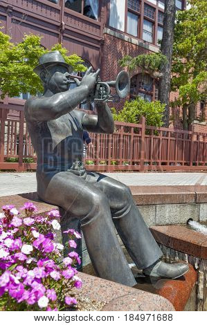 Kobe, Japan - April 2016: Statue Of Trumpet Player In Front Of Weathercock House In Historic Area Of