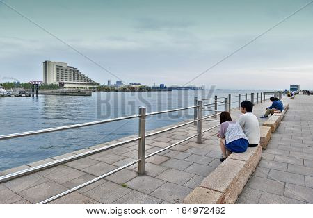 Kobe, Japan - April 2016: People Relaxing At Kobe Port Waterfront