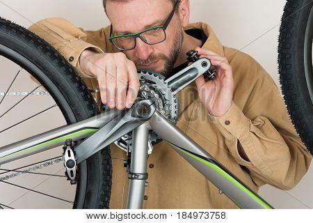Bearded Caucasian Man Repairing  The Mtb Bicycle