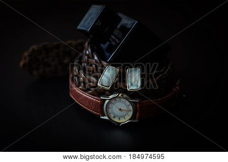 Stylish male accessories. Watch with perfume belt and cuff