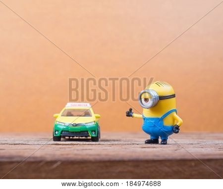 BANGKOK THAILAND - MARCH 27 2017: Minions toy figures on wooden background Minion is a figure from Despicable Me and Minions(2015) produced by Illumination Entertainment for Universal Pictures.