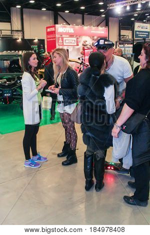 St. Petersburg Russia - 15 April, Different people at the motor show,15 April, 2017. International Motor Show IMIS-2017 in Expoforurum. Visitors and participants of the annual moto-salon in St. Petersburg.