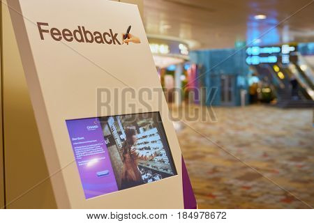 SINGAPORE - CIRCA SEPTEMBER, 2016: close up shot of feedback kiosk in Singapore Changi Airport. Changi Airport is one of the largest transportation hubs in Southeast Asia.