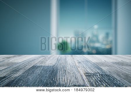 Close up of wooden desk. Blurry interior in the background. Mock up 3D Rendering