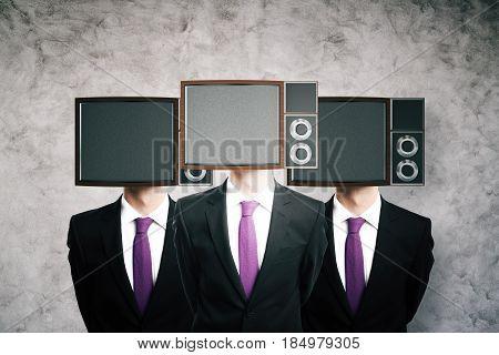 Obsolete TV screen headed men on concrete background. Mock up 3D Rendering