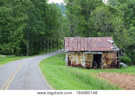 Old barn by the road in a country setting