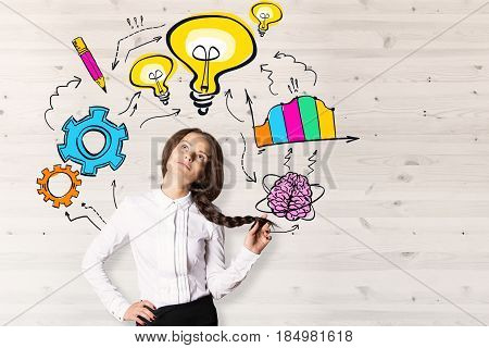 Daydreaming young european woman on wooden background with drawn lamps and business charts. Success concept