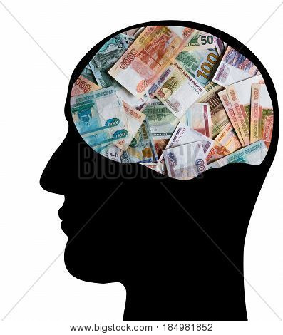 Profile of the head of a businessman. Many monetary denominations of different denominations. Rubles and dollars.