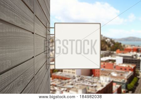 Close up of empty square poster on wooden building. City background. Pub/bar/cafe/shop concept. Mock up 3D Rendering