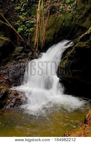 Bang Pae Waterfall. Beautiful Thai natural waterfall in a rocky gorge. Vertical landscape.