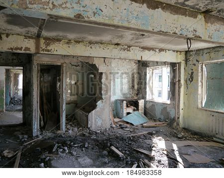 devasteting interior of abandoned broken building in nothern russia