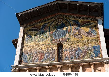 Detail of the pediment of the Basilica of San Frediano (in romanesque style - XII century) in the ancient town of Lucca Toscana (Tuscany) Italy Europe