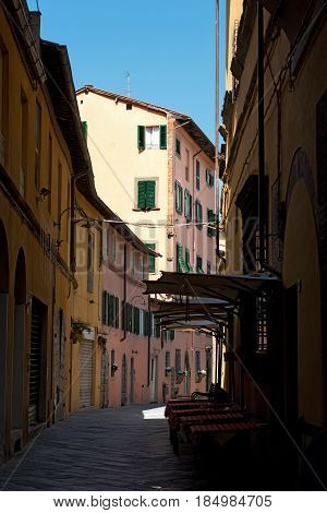 Picturesque alley with buildings in the ancient town of Lucca Toscana (Tuscany) Italy Europe