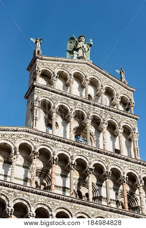 Detail of the church of San Michele in Foro in Pisan-romanesque style in the ancient town of Lucca Toscana (Tuscany) Italy Europe