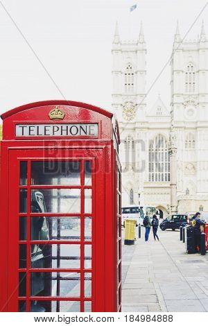 Red Phone Box In London And Westminster Cathedral In The Background