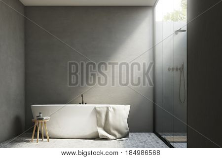 Gray bathroom interior with white walls a tub standing near it and a shower with a glass wall. 3d rendering mock up