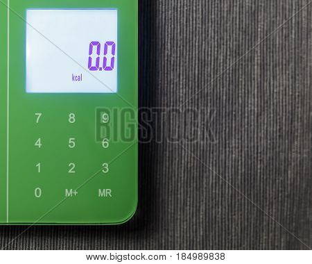 Zero kcal on the digital screen of kitchen scales
