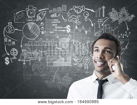 African Man With Phone And Business Scheme