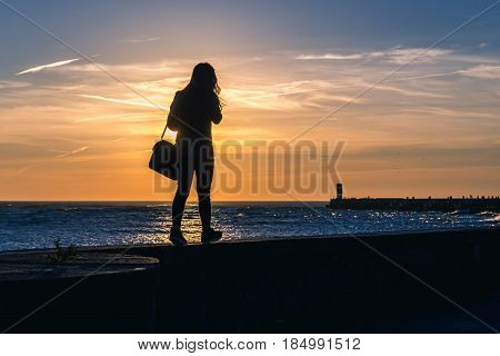 Silhouette of woman on a promande of Porto city Portugal