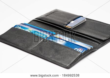 Chicago,IL,USA,Feb-12,2017,Close up of an open wallet with credit cards with Chase,Chase Disney,Citi Simplicity and Master card logos (for editorial use only)
