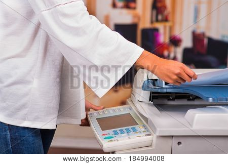 Young Businesswoman Using Copy Machine At The Office.