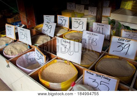 Bacong Philippines - 26 June 2016: Many varieties of rice on the local market. Asian food market. Rice selling by low prices. Asian agriculture and rice growing. Food production industry. Rice mill