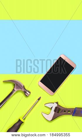Vertical mobile phone repair background or template for smartphone fixing company's advertisement in print. Blank empty copy space for text and content. Cellphone and tools on green and blue texture.