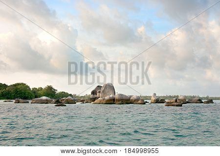 Natural Granite Rock Formation Placed In The Ocean Next To White Sand Beach  In The Morning Belitung