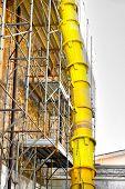 discharge tube yard debris building scaffolding construction dump poster