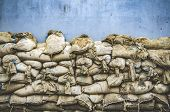 Old sandbag wall for flooding defense or fortification poster
