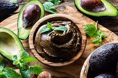 Vegan food. Raw avocado chocolate mousse pudding with mint in olive wooden bowl. Organic healthy dessert poster