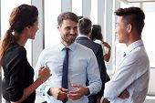 Group Of Businesspeople Having Informal Office Meeting poster